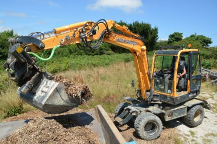 Hyundai 55w9a digger in action