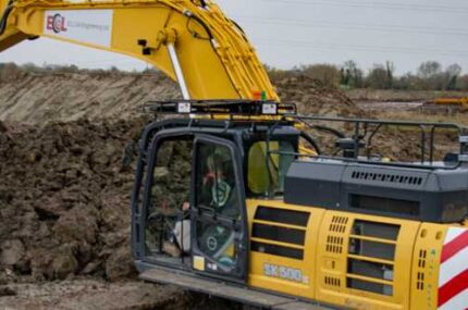 ECL Kobelco SK500 excavator moving earth on a civil engineering project in the UK
